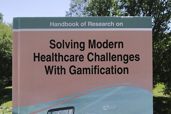 "Livro ""Solving Modern Healthcare Challenges with Gamification"""